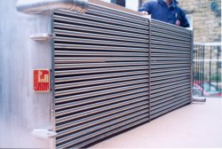 Plain tube steam-air heater manufactured entirely from grade 316L stainless steel for cereal drying application.